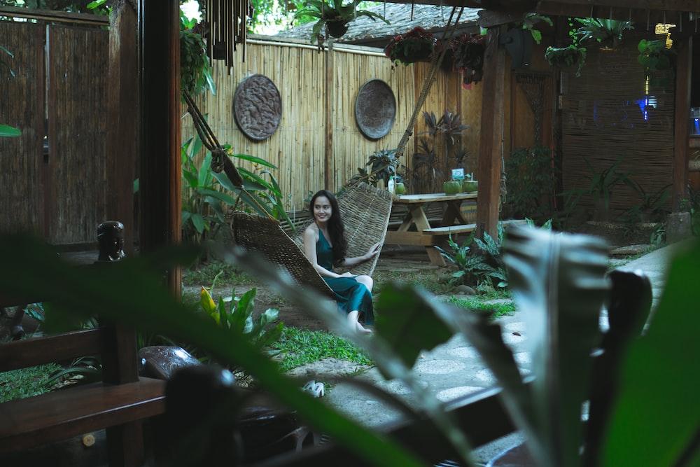 woman sitting on hammock on focus photography
