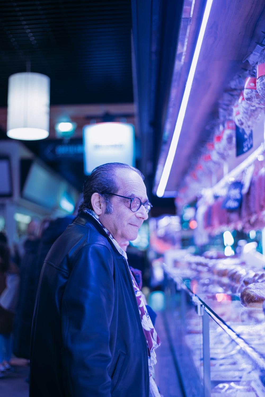 man looking at items