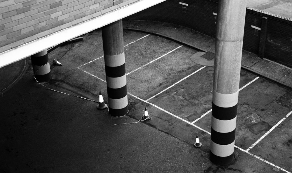 grayscale photography of building pillars