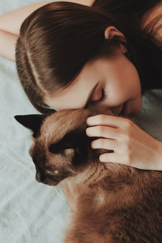 woman touching cat