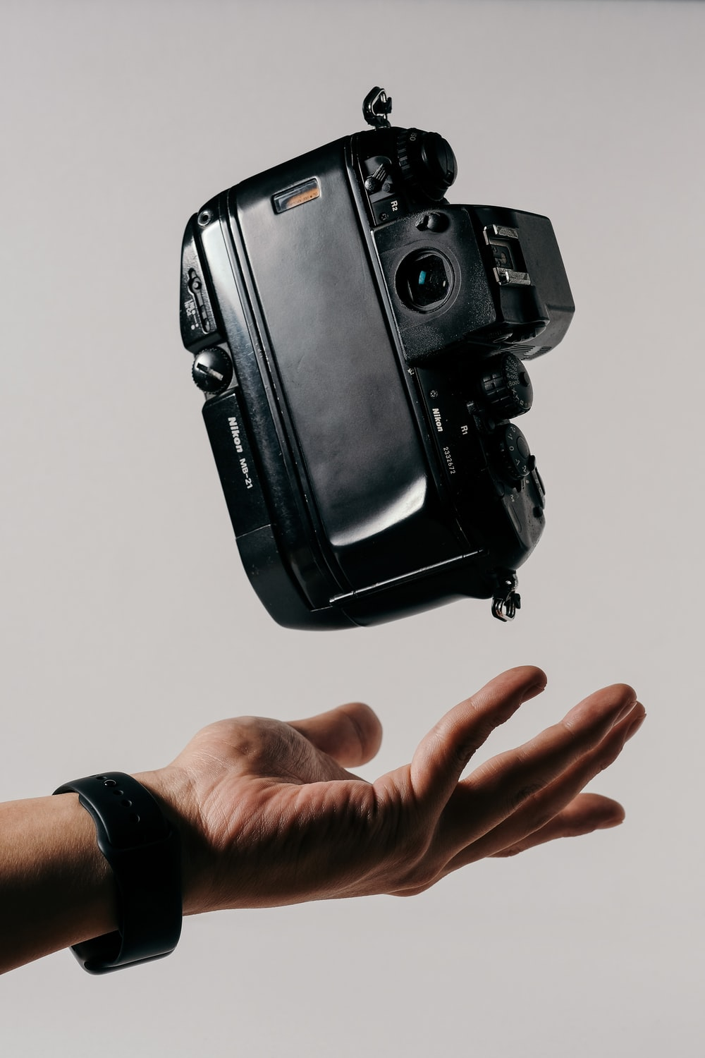 person catching black camcorder