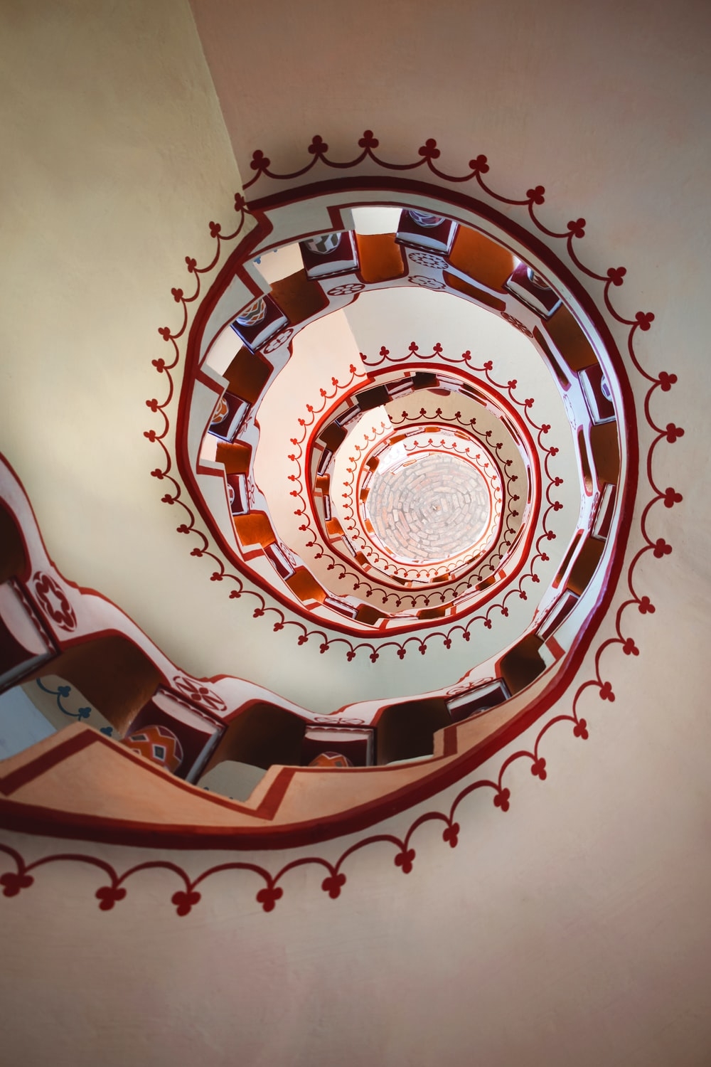 white and red spiral stairs