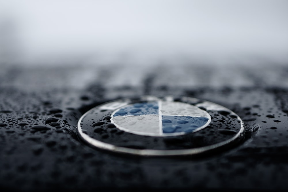 shallow focus photo BMW logo
