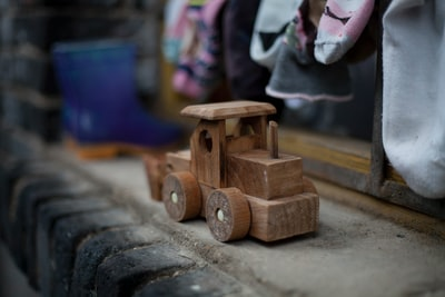 In the rural areas of Yunnan, China, children play and enjoy playing with the simplest of things including this wooden bulldozer - something they might have never seen before.