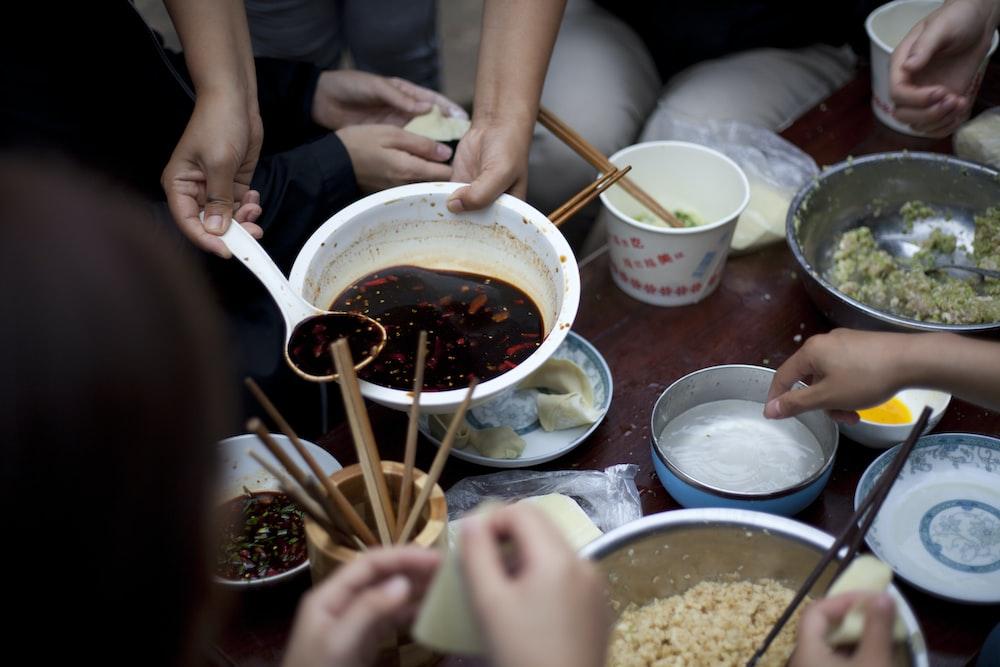 people eating using chopsticks