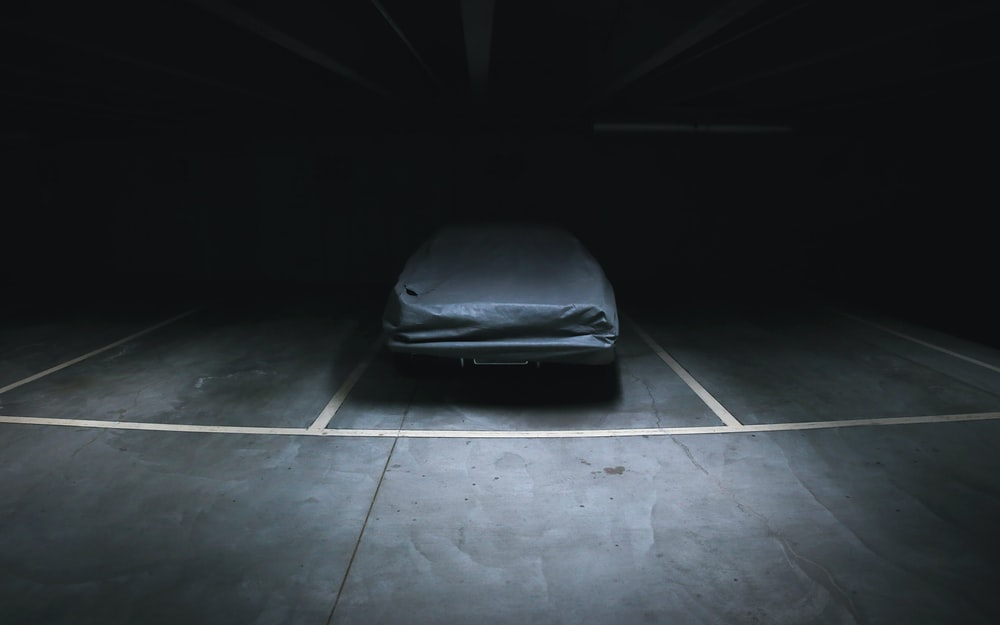 covered vehicle in empty parking lot