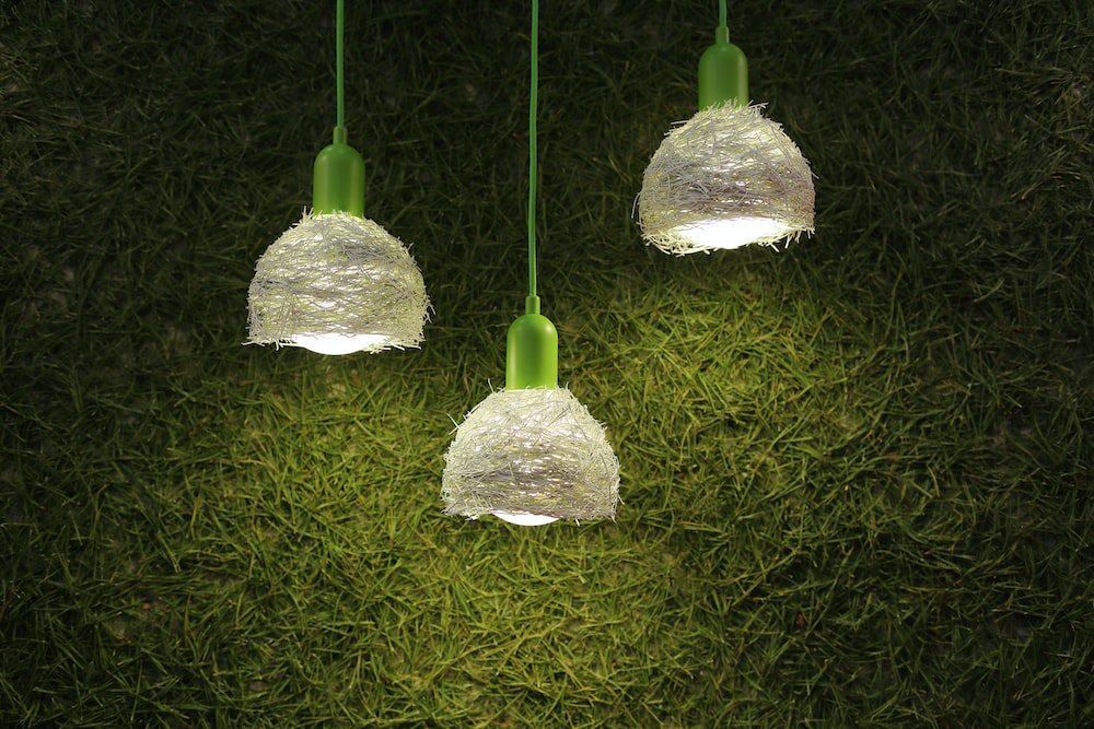 three green-and-white pendant lamps