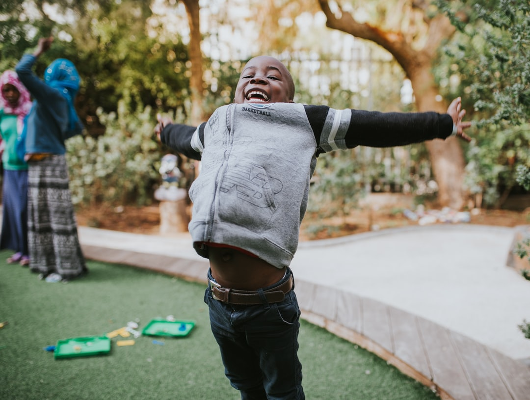 """A young boy, and resident of one of the """"Save a Child's Heart"""" locations in Israel jumps for joy.  Save a Child's Heart is a humanitarian organization with a mission to improve the quality of pediatric cardiac care for children from developing countries who suffer from heart disease, and who cannot get adequate medical care in their home countries."""
