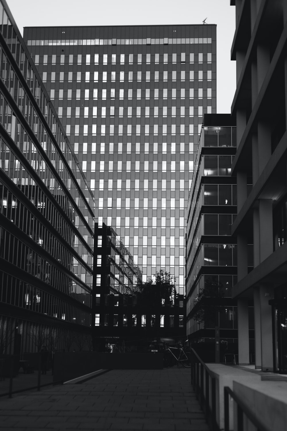 grayscale photography of high-rise buildings
