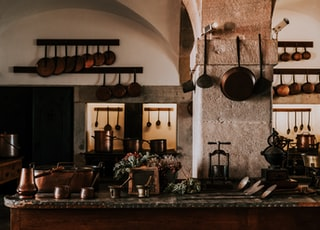kitchen filled with cooking pans and kitchen utensils