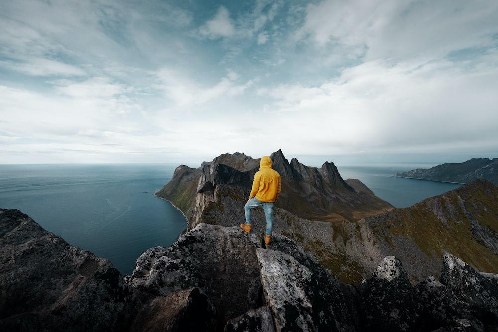 man standing on mountain peak