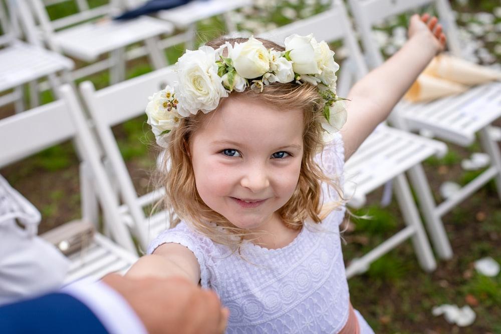 smiling girl wearing white dress