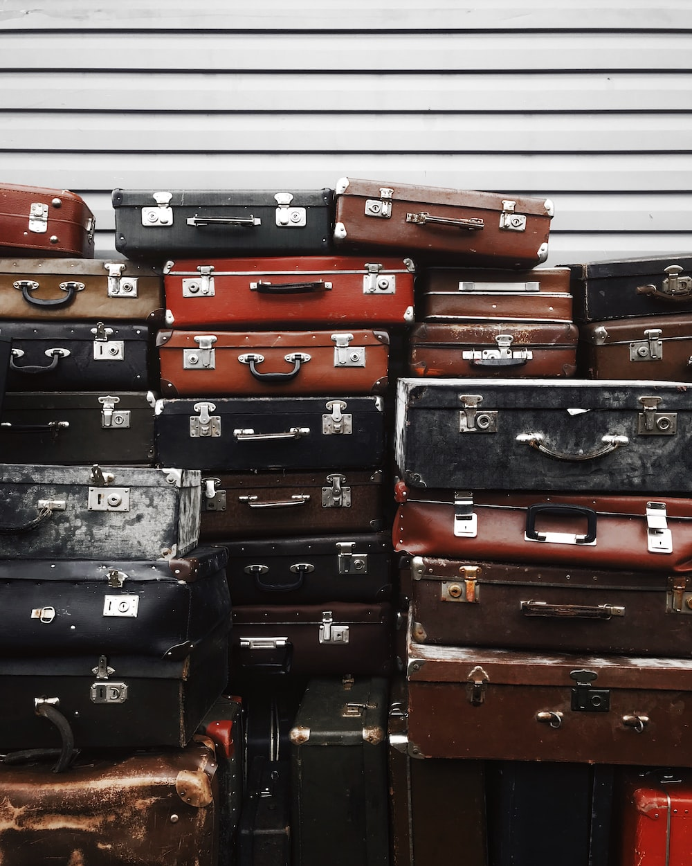 stacks of assorted suitcases