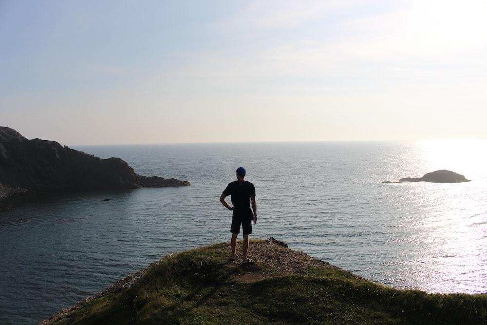 man standing near the ocean