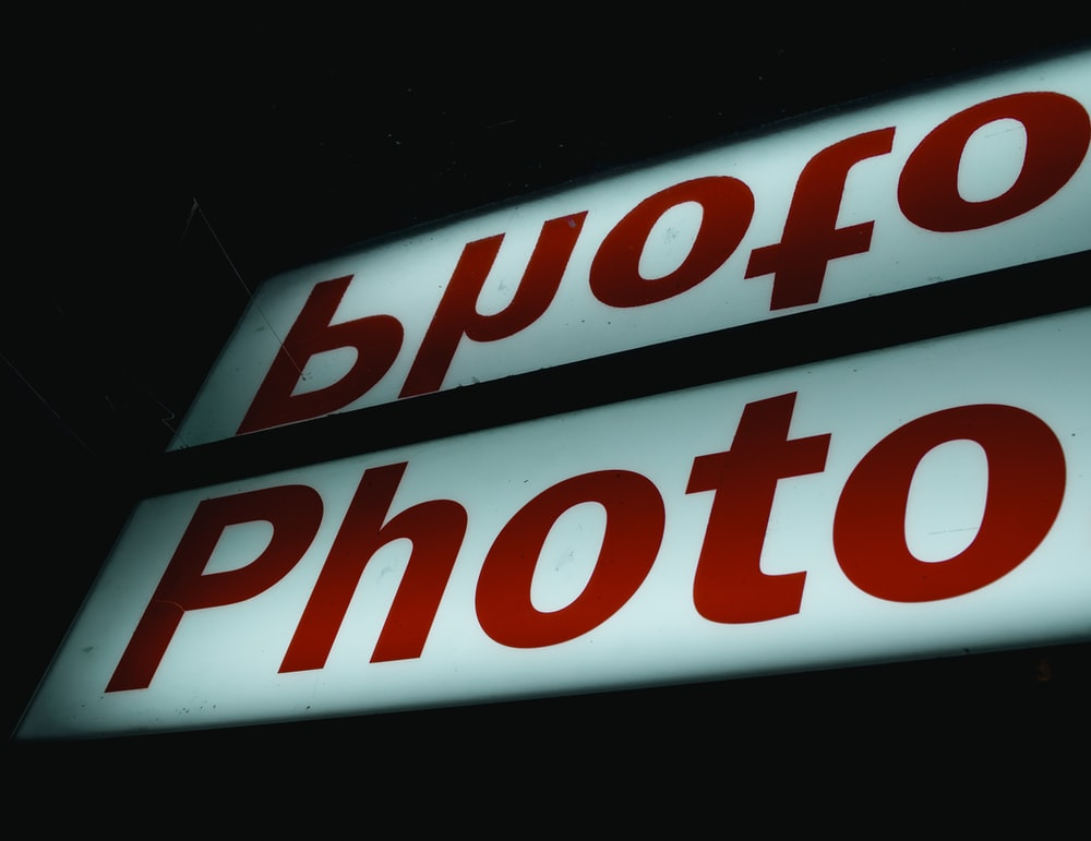 red and white Photo signage