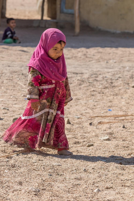 girl wearing pink hijab during daytime