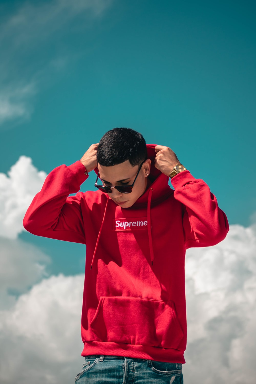 man wearing red Supreme pullover hoodie