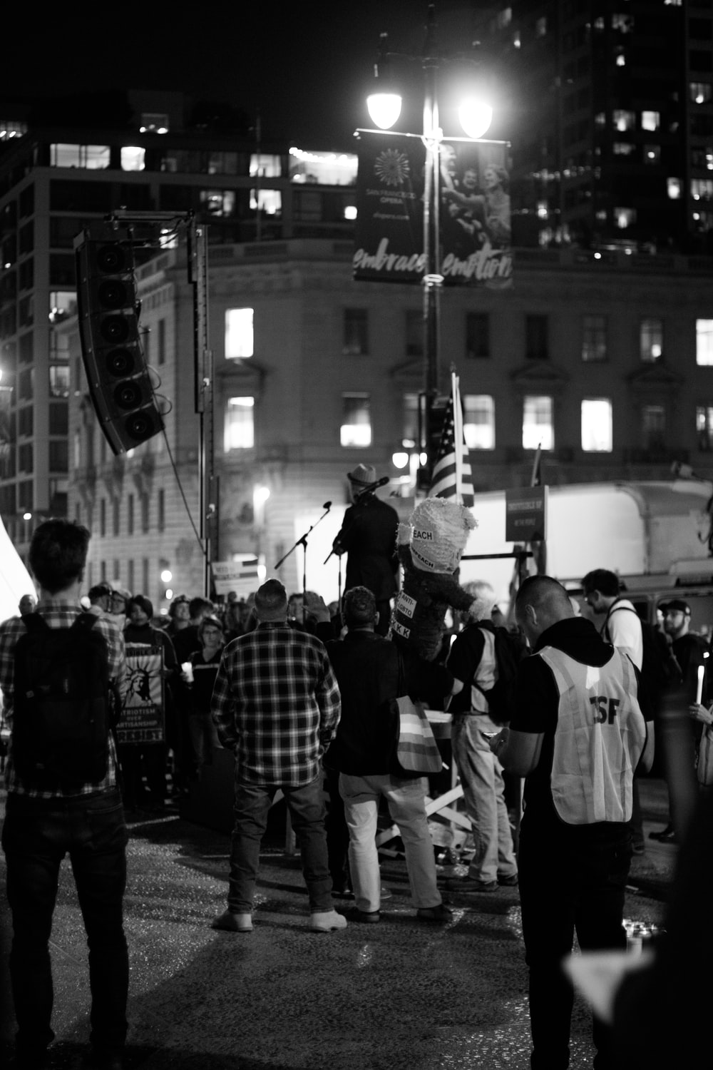 grayscale photography of people protesting on road