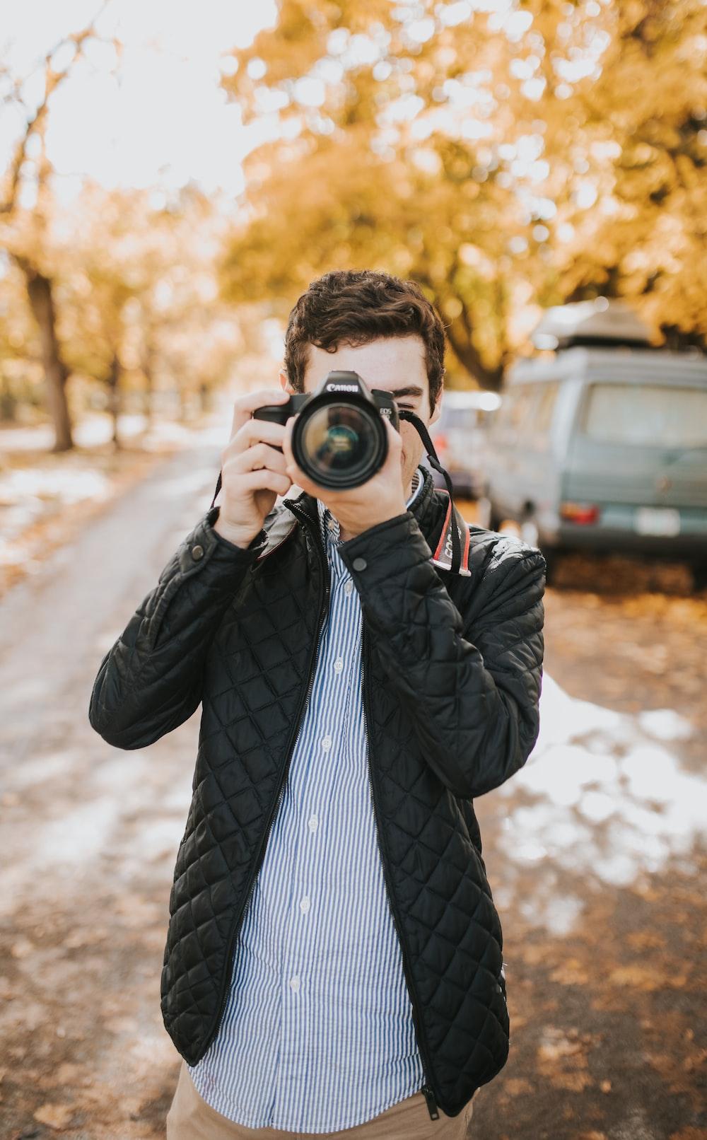man taking photo during daytime