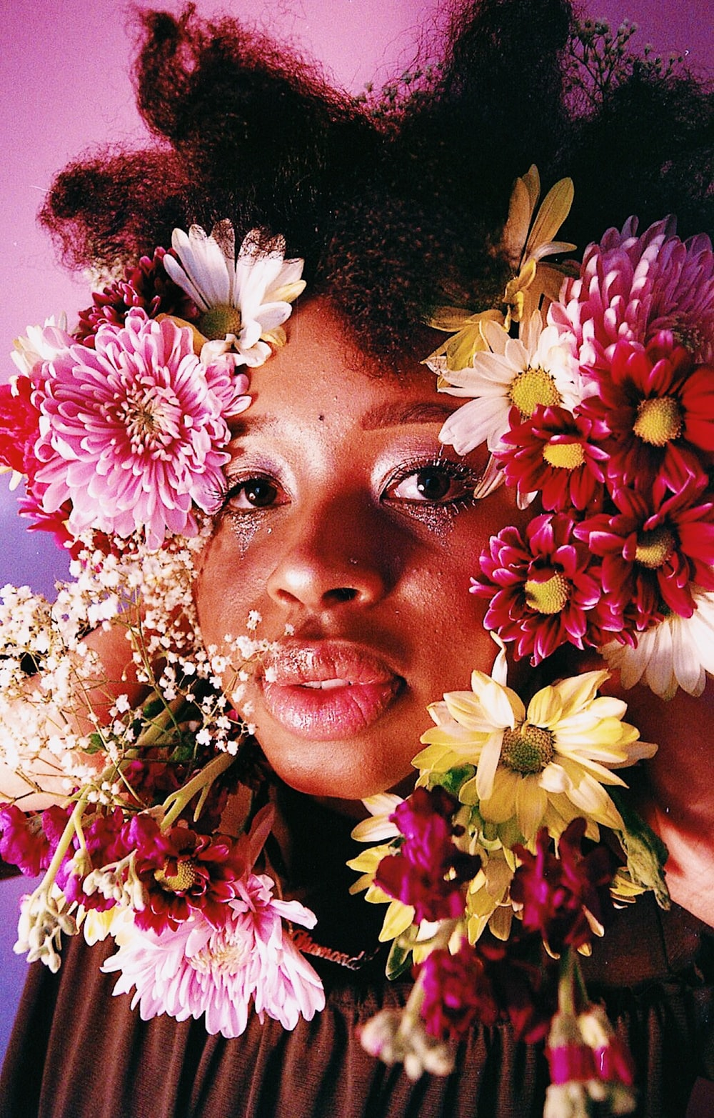 woman's face covered by flowers