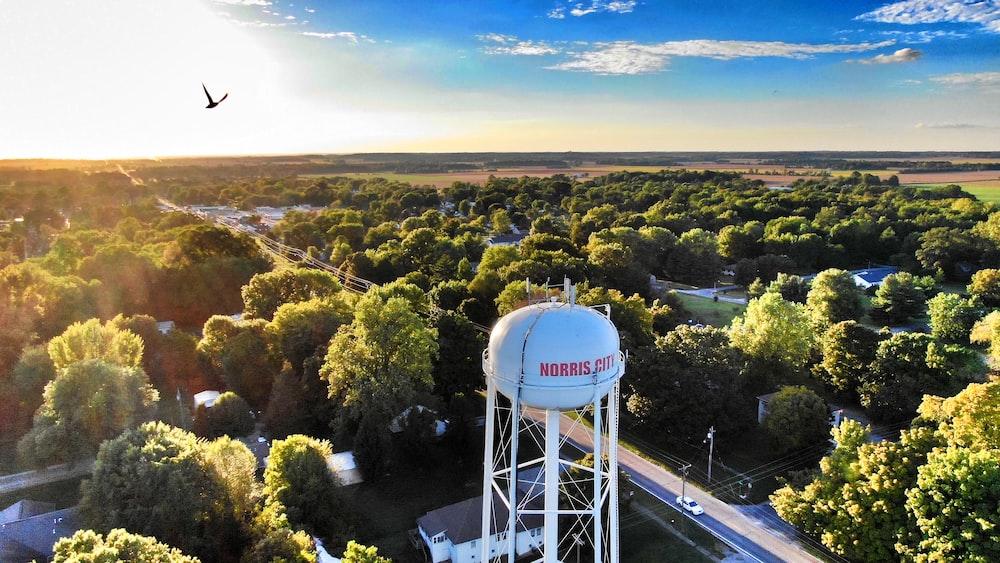 bird's-eye view photography of water tank near city