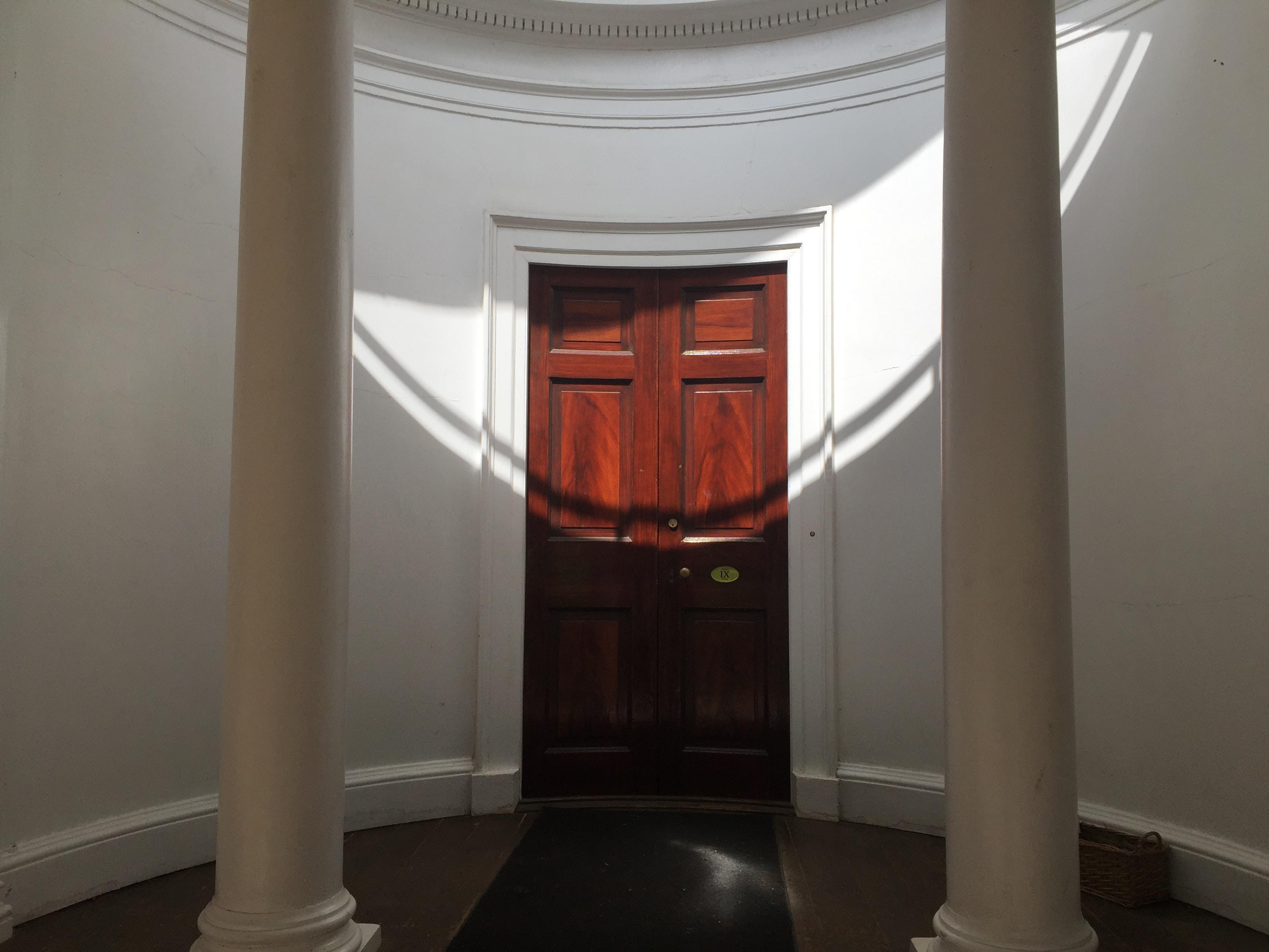 close brown wooden door
