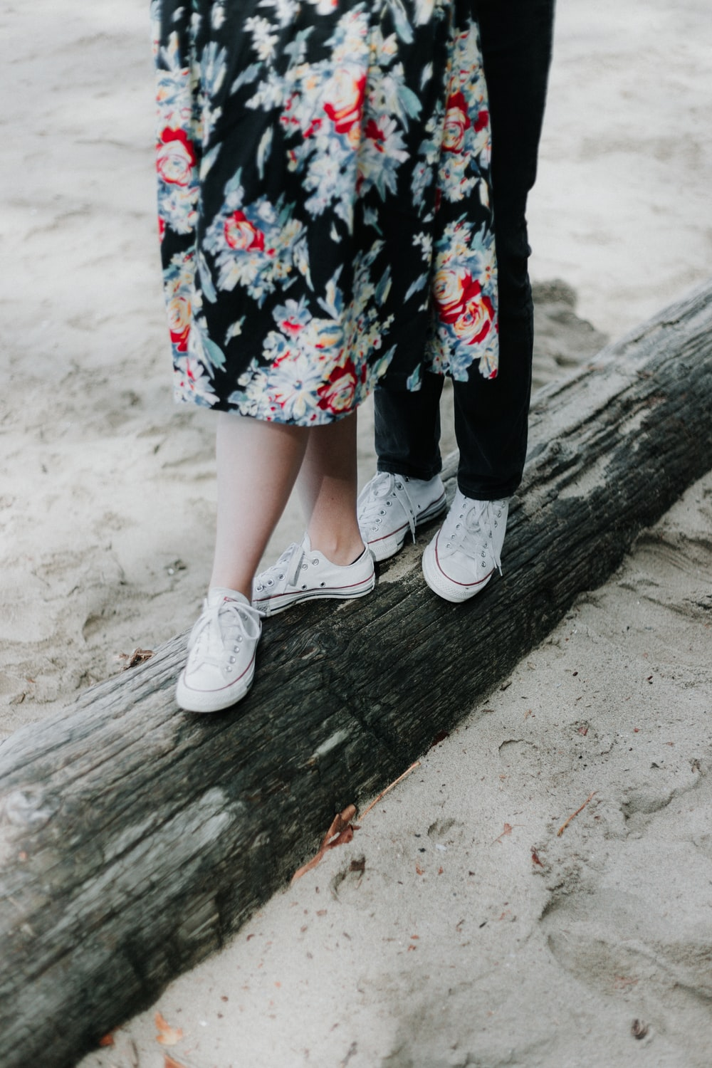 two pairs of white low-top shoes