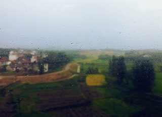 I was in a speeding train when I took this picture, coming back to my hometown, everything outside the window is so beautiful and familiar,raindrops scattered by moist wind on the window of the train,vague scenery like a vintage Barbizon oil painting for it's distant.
