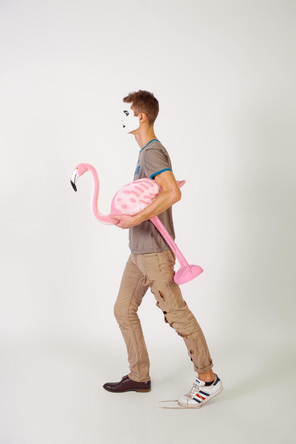 man carrying flamingo ornament illustration