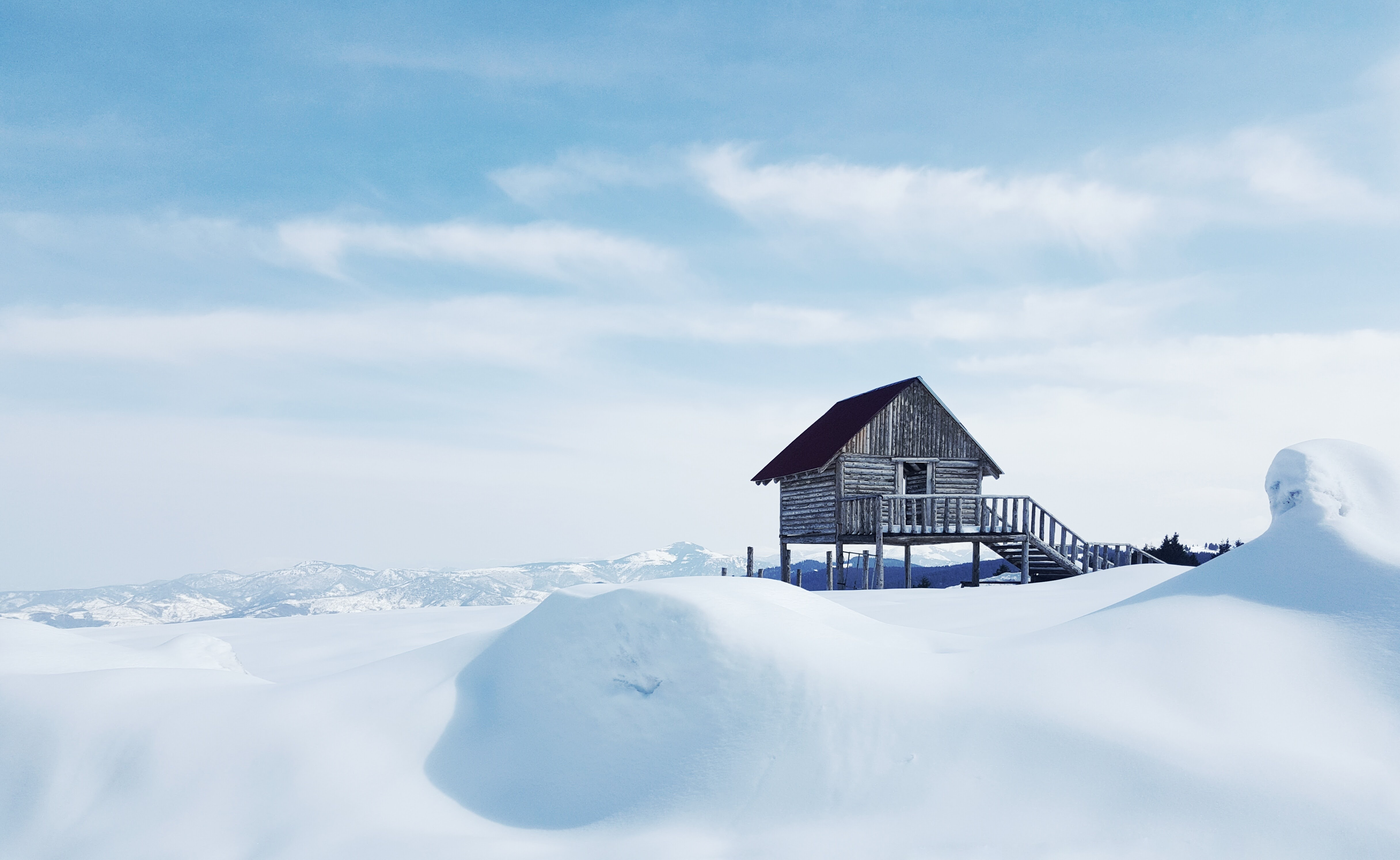 brown cabin on snowy iland