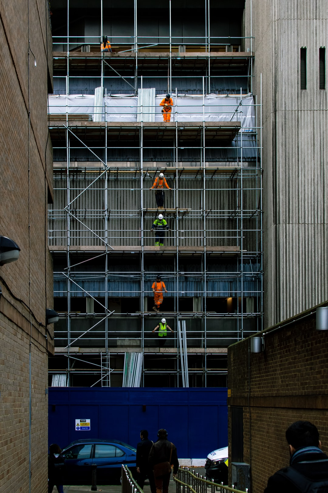 I noticed this amazing lineup of builders on my way into work recently. I fell in love with the arrangement of them and loved the contrast of their hi-vis equipment against the background.