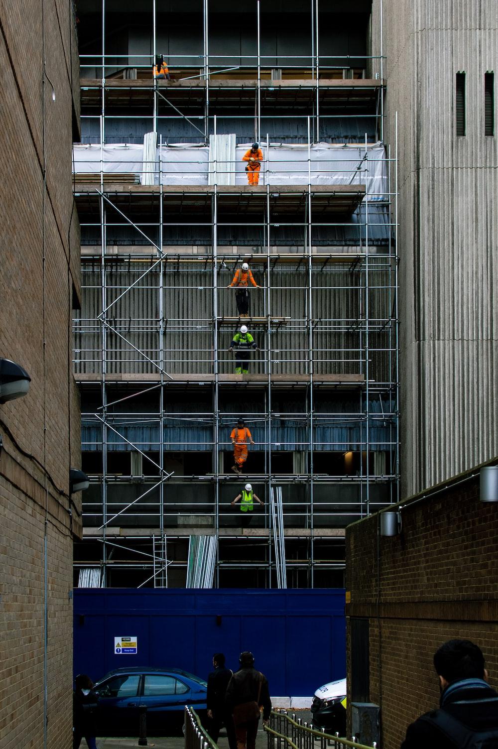 men on scaffoldings