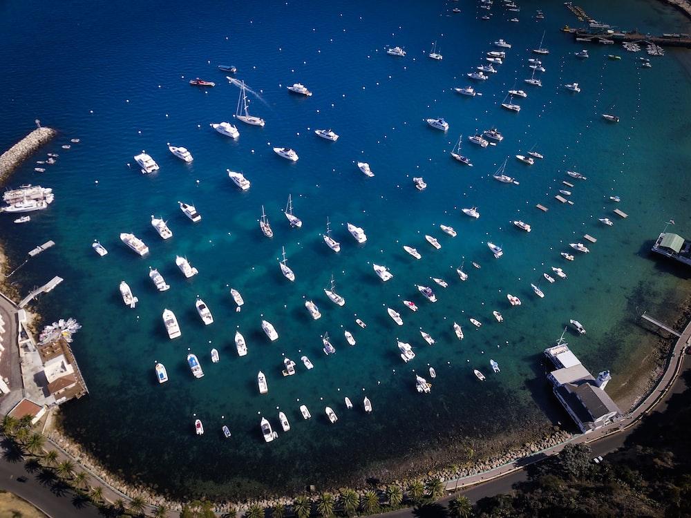 boats in body of water near island