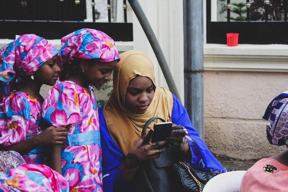 three girls looking at smartphone
