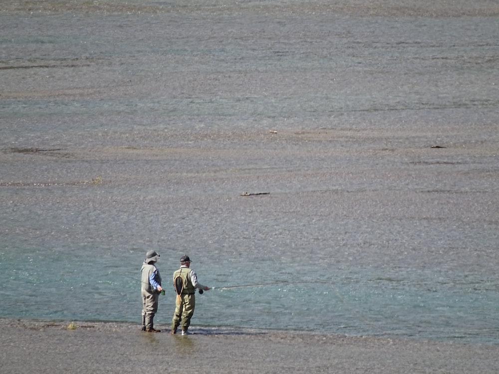 two men fishing at sea