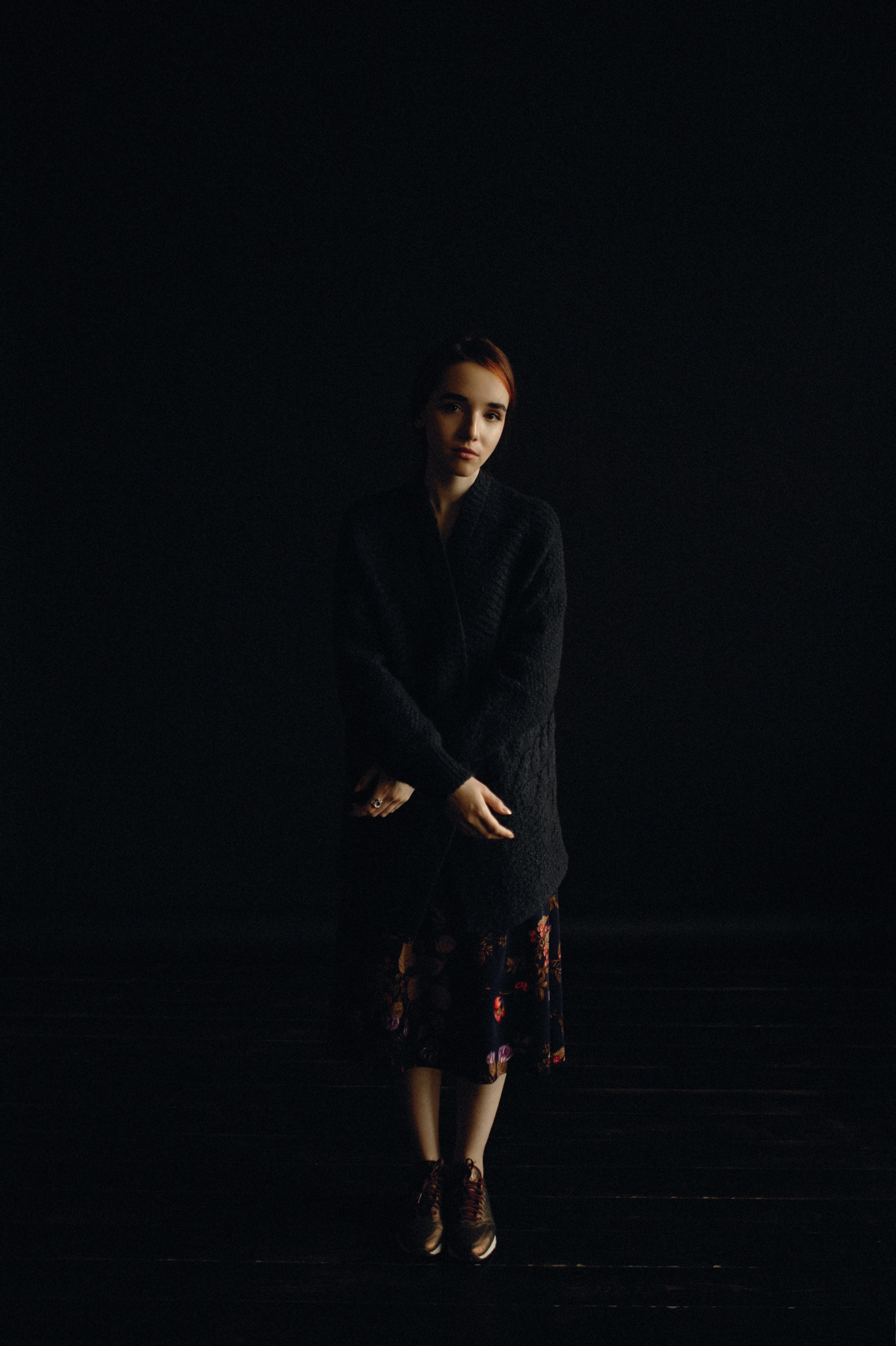 woman wearing black cardigan and skirt