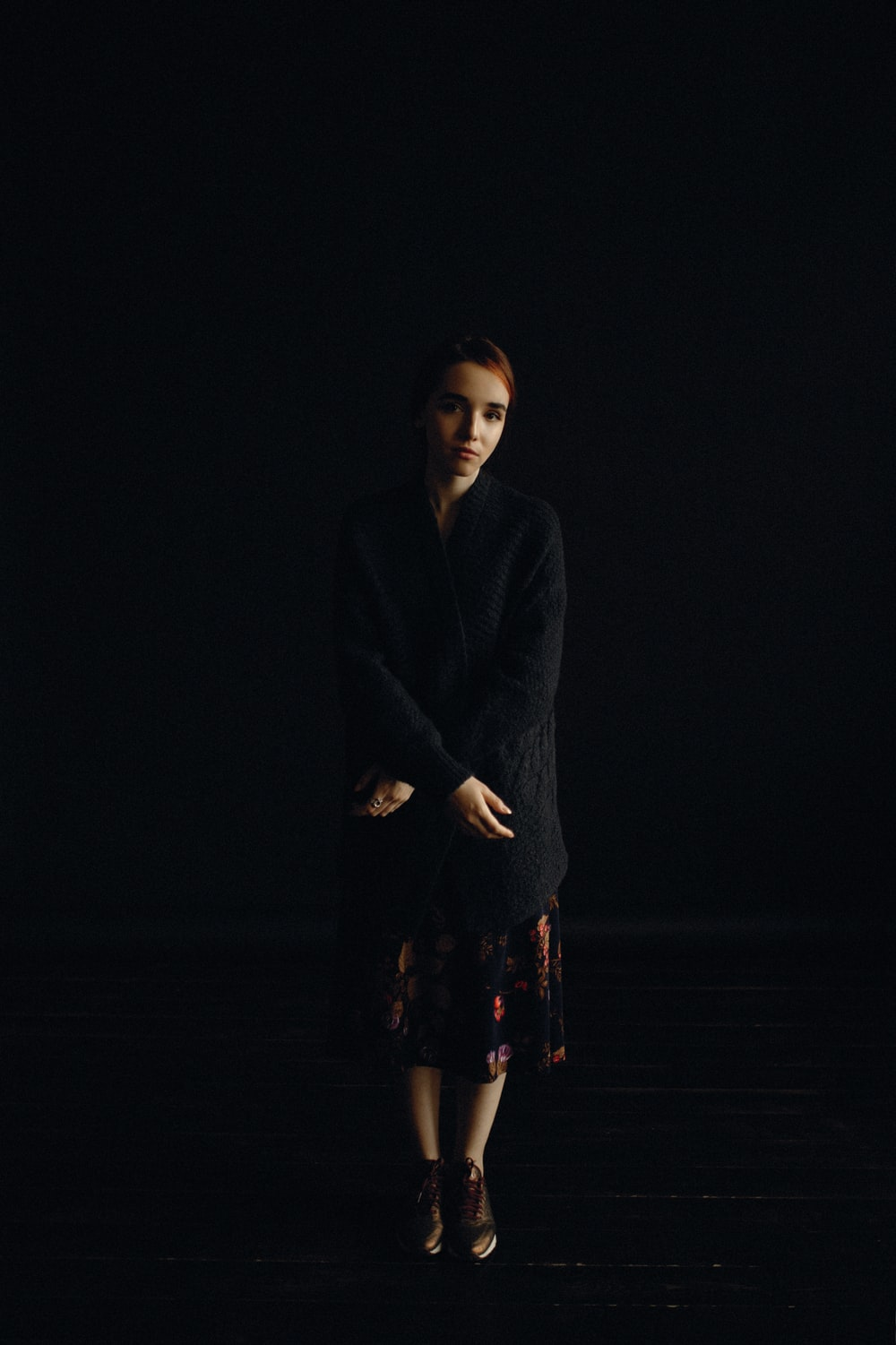 woman wearing black cardigan and skirt