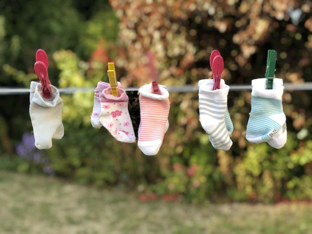 five pairs of socks pinned on clothesline