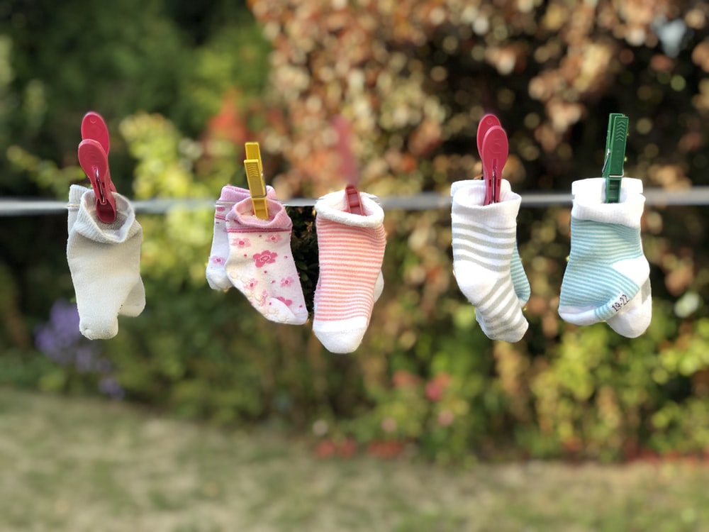 five pairs of socks pinned on clothesline