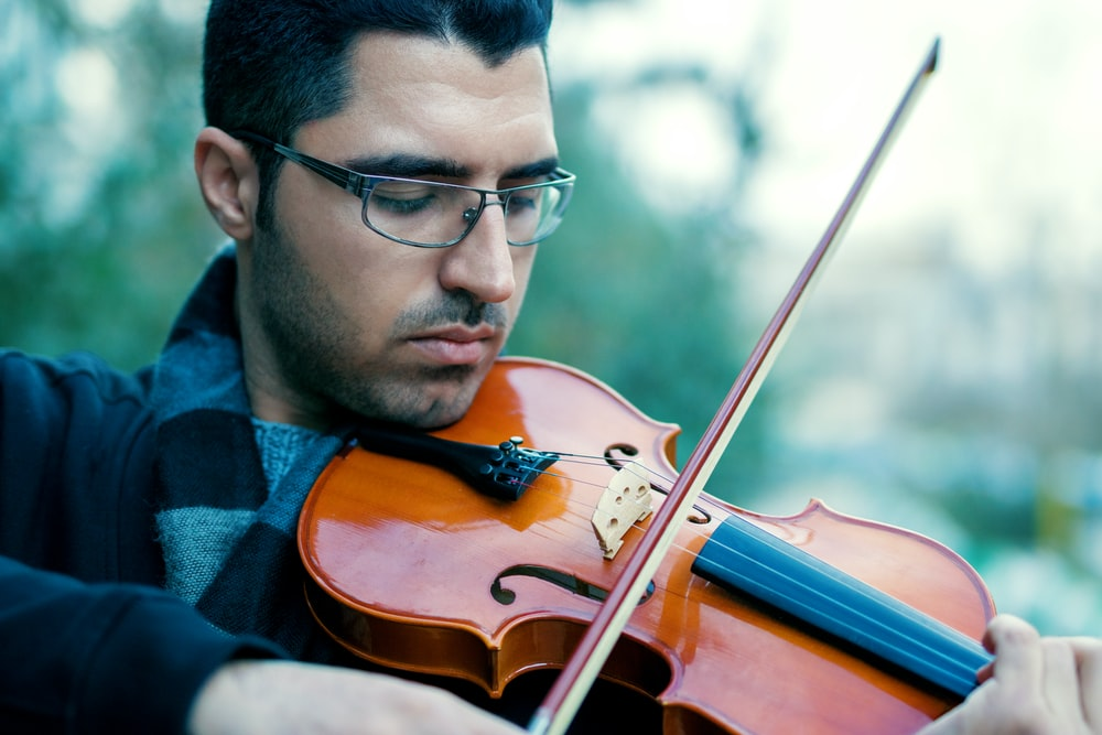 man playing violing