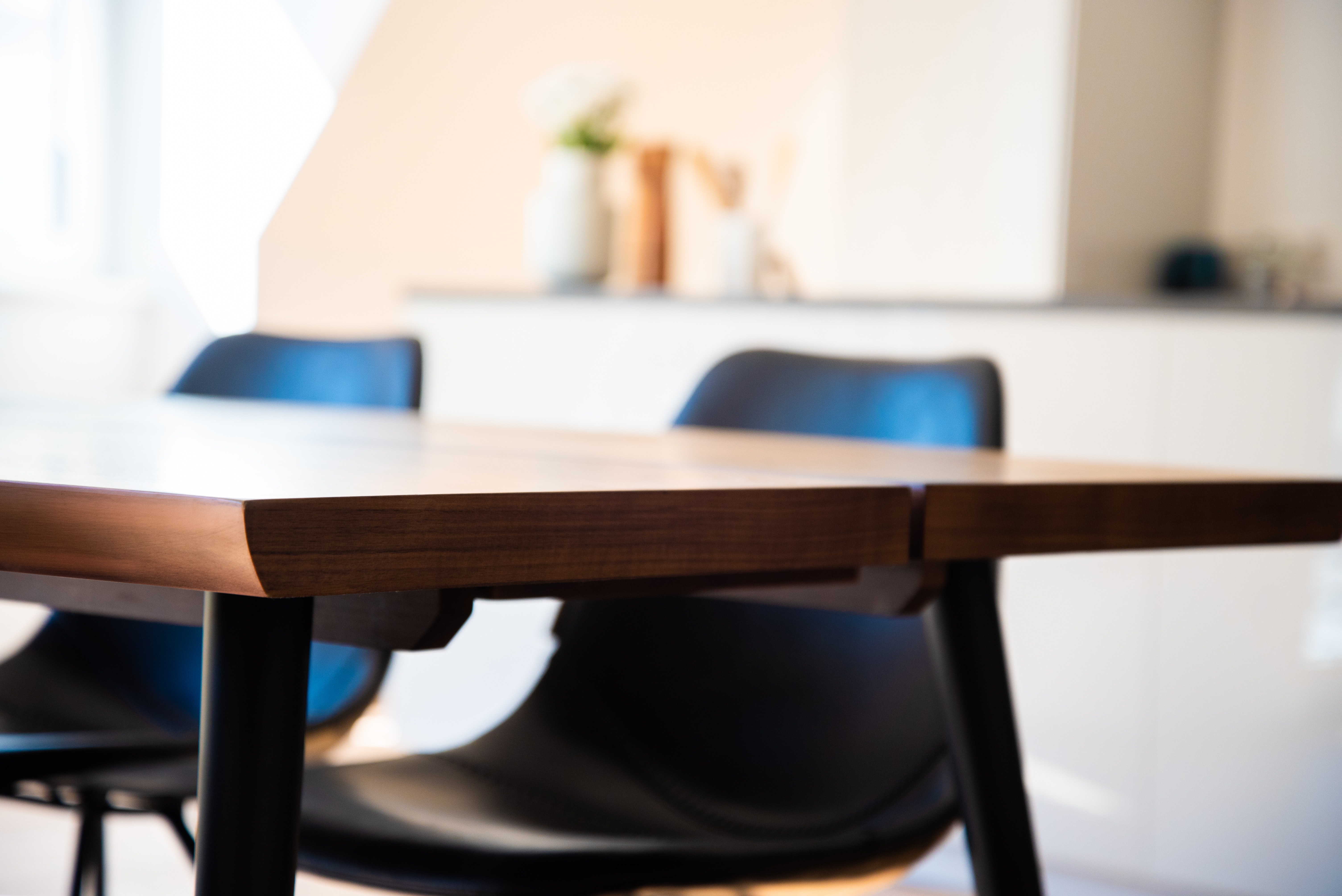 selective focus photography of table and chairs
