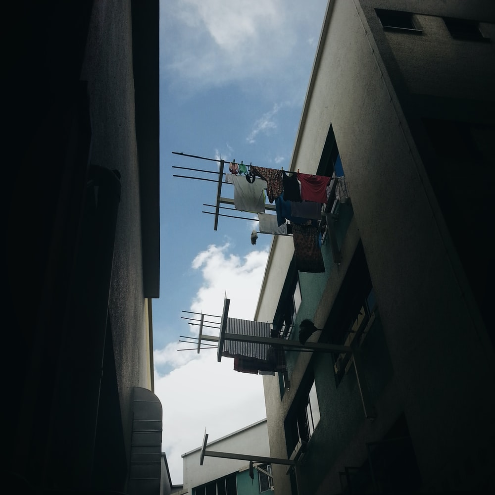 clothes hanging near window during daytime