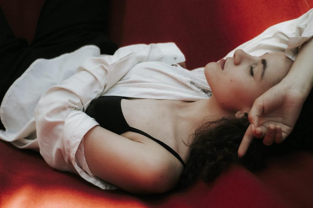 Emma Watson lying on sofa