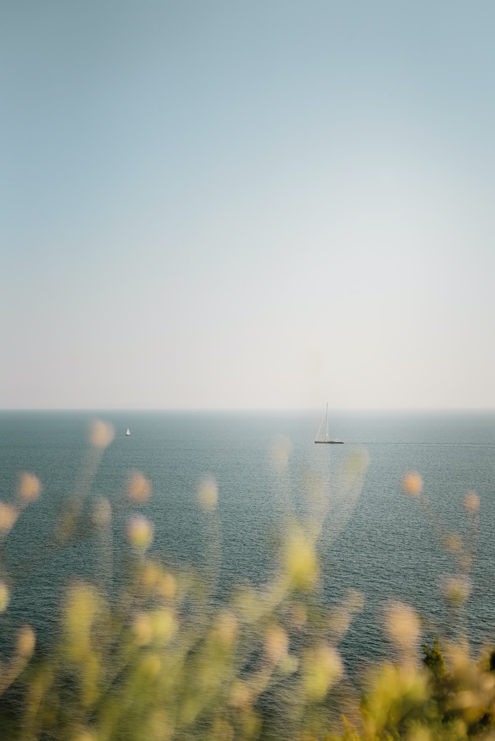 schooner boat on calm sea during daytime