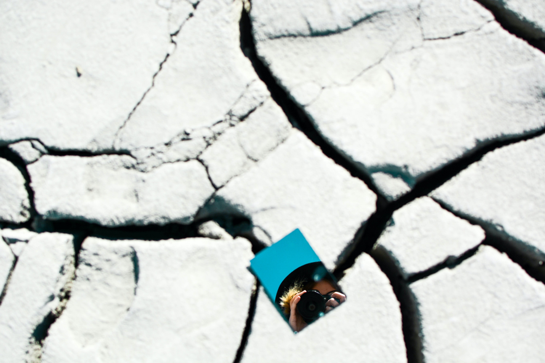 blue mirror on cracked ground