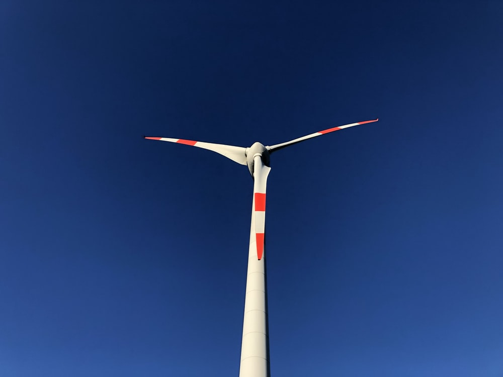 white and red wind turbine