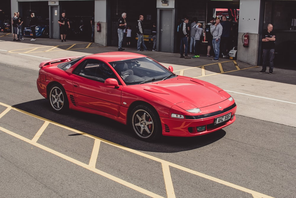 red sports coupe on road