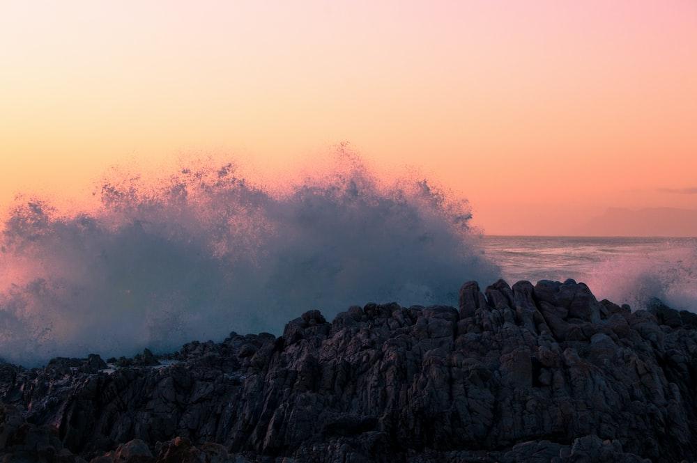 sea wave splashing on rocks