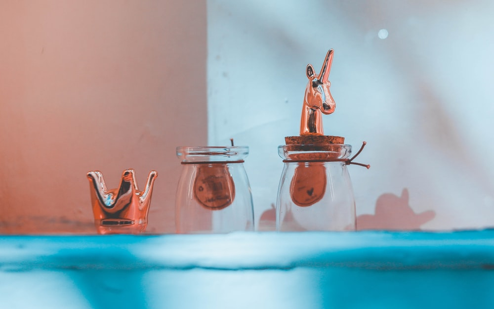 standing clear glass jars with unicorn lid
