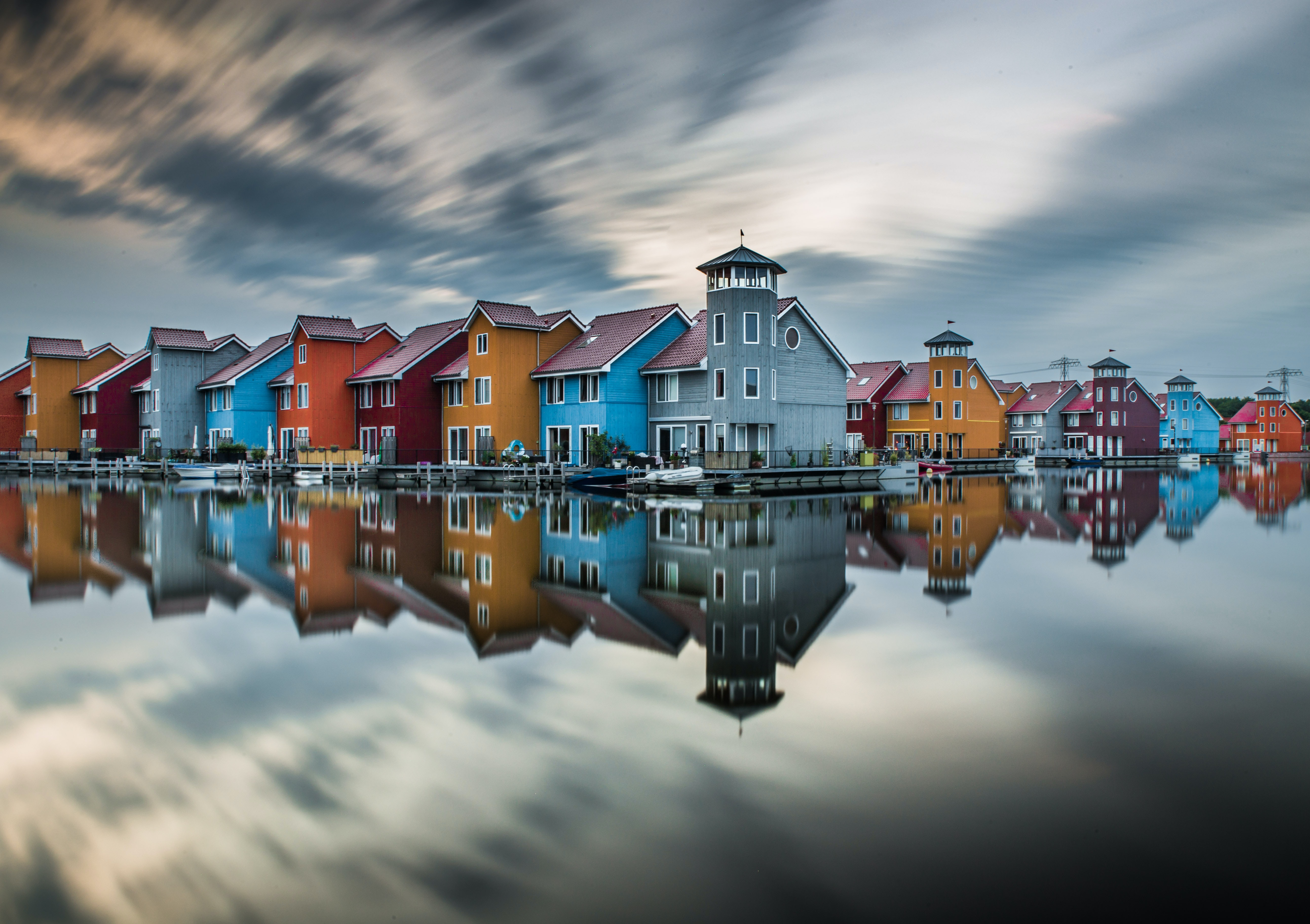 houses reflecting on body of water
